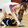 WARREN DILLAWAY / Star Beacon<br /> COLEEN O'CONNOR (top) of Jefferson wrestles for the ball with Erin Fahl of Riverside on Tuesday night during the Star Beacon-Ed Batanian Senior Classic at Jefferson High School.