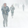 WARREN DILLAWAY / Star Beacon<br /> DAN MCGRATH of Geneva leads a group of runners during a snowy Shamrock 2 Mile Saturday in Ashtabula.