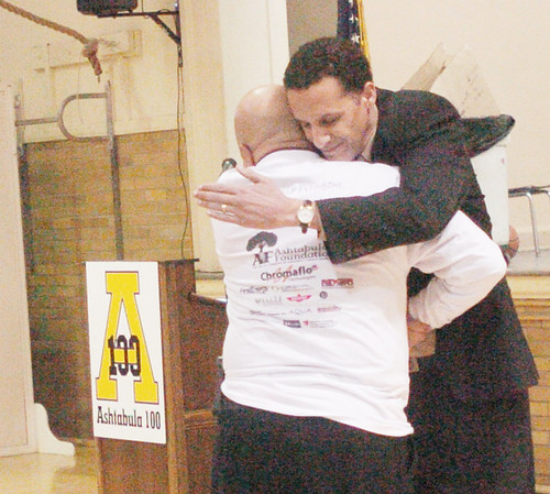 WARREN DILLAWAY / Star Beacon<br /> JONATHAN LEE, chief executive officer of Signature Health, was the keynote speaker at Ashtabula 100  on Saturday at St. John High School. The group is seeking to empower black men to make a difference in the community. Lee (facing) embraces Rev. German Womack after his address.