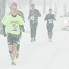 WARREN DILLAWAY / Star Beacon<br /> WILLIAM TAGGART (49),  a junior at Lakeside, leads a group of runners during the Shamrock 2 Mile Saturday in Ashtabula.