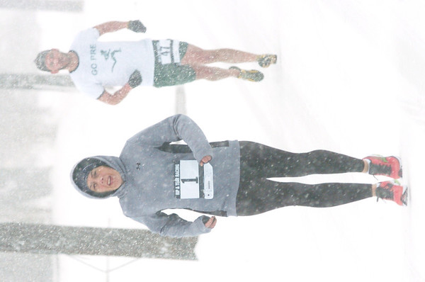 WARREN DILLAWAY / Star Beacon<br /> CHRISTINA CAPO won first place for women in the Shamrock Kickoff 2 Mile Saturday in Ashtabula with CKenny Sinclair close behind.