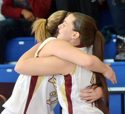 WARREN DILLAWAY / Star Beacon<br /> GEENA GABRIEL of Pymatuning Valley, who scored her 1,000th point on Saturday during the Division III district championship game against Hawken, receives a hug from teammate Taylor Lipinsky (right) at Ravenna. She also got to cut down a portion of the net after winning the championship.