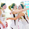 WARREN DILLAWAY / Star Beacon<br /> GEENA GABRIEL (center) receives a hug, after scoring her 1,000th point,from Pymatuning Valley teammate Kelsea Brown (right) as Megan Stech (22) looks on during the Division II district  championship game at Ravenna on Saturday afternoon.