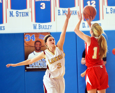 WARREN DILLAWAY / Star Beacon KELSEA BROWN (3) of Pymatuning Valley (left) reaches to block a shot by Hannah O'Day of Hawken on Saturday during the Division III district championship game at Ravenna.