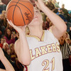 WARREN DILLAWAY / Star Beacon<br /> GEENA GABRIEL of Pymatuning Valley scores her 1,000th point on Saturday during the Division III district championship game against Hawken at Ravenna. She also got to cut down a portion of the net after winning the championship.