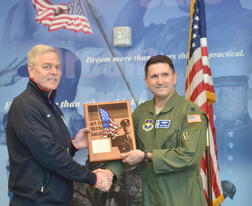 WARREN DILLAWAY / Star Beacon LT. COLONEL TERRY GRIMM (right) of the U.S. Air  Force presents Ron Clutter, founder of Spire Academy, with an award for the academy's help in training U. S. Air Force recruits on Friday in Harpersfield Township.