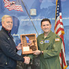 WARREN DILLAWAY / Star Beacon<br /> LT. COLONEL TERRY GRIMM (right) of the U.S. Air  Force presents Ron Clutter, founder of Spire Academy, with an award for the academy's help in training U. S. Air Force recruits on Friday in Harpersfield Township.