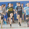WARREN DILLAWAY / Star Beacon<br /> GRAND VALLEY track athletes (from left) Tylor Whitely, Callie Forrest, Peter Tropp and Chelsa McArdle work on agilty drills prior to practice on Monday in Orwell.