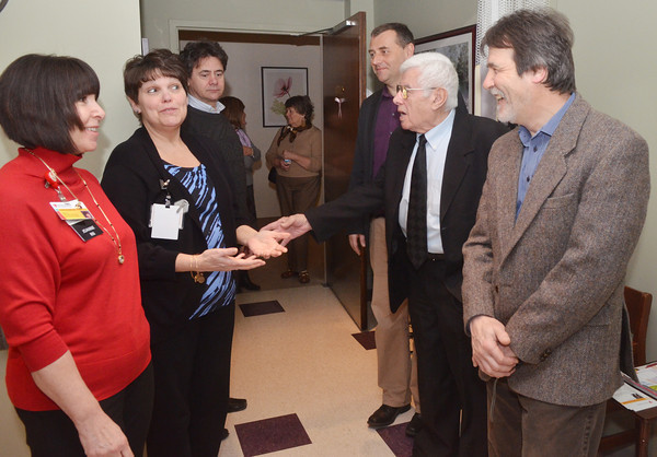 WARREN DILLAWAY / Star Beacon<br /> DAVID PANDY SZEKERES, a dual citizen of Canada and Hungary, (far right) tours UH Conneaut Medical Center on Tuesday morning. He will be the executive director of Sharing Human Resources Abroad after the retirement of Conneaut founder Rev. Stephen Szyilagi (second from right). (From left) Jo Anne Surbella, director of ambulatory services, and Bonnie Blood, radiology manager, lead the tour with Janos Beczc and Andrae Fosarisi, administrator from a hospital in Budapest, Hungary, Szilagyi and Pandy-Szekeres.