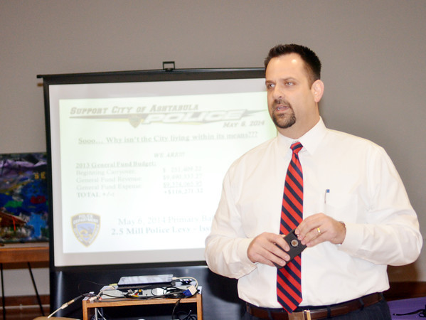 WARREN DILLAWAY / Star Beacon<br /> ASHTABULA CITY Manager James Timonere discusses police department finances during a public forum held at St. Peter's Episcopal Church in Ashtabula on Tuesdsay evening.