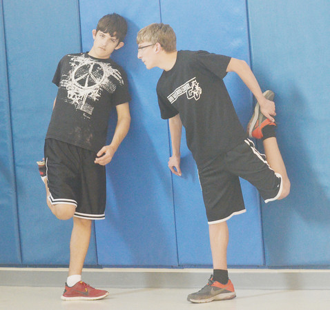 WARREN DILLAWAY / Star Beacon<br /> RYAN GRIMM (left) and Grand Valley track teammate Jack O'Neal stretch prior to practice on Monday in Orwell.