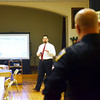 WARREN DILLAWAY / Star Beacon<br /> ASHTABULA CITY Manager James Timonere discusses police department finances during a public forum held at St. Peter's Episcopal Church in Ashtabula on Tuesdsay evening. Ashtabula Police Officer Tony Tulino listens to the presentaton (right back to camera).