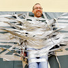 WARREN DILLAWAY / Star Beacon<br /> JEFF BAYLOR, a Superior Intermediate School teacher, smiles while hanging from a gymanasium wall on Friday in Ashtabula.