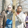 WARREN DILLAWAY / Star Beacon<br /> ED GREATHOUSE (right) and Bob Hazeltine  (left) carry a large wooden cross during a Good Friday Cross Walk on Elm Avenue in Ashtabula. The event was held to remember Christ carrying the cross on Good Friday.