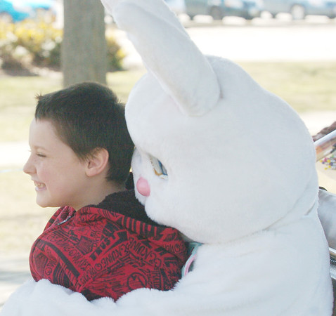 WARREN DILLAWAY / Star Beacon<br /> WESLEY JEFFREY II, 9, of Ashtabula poses with the Easter Bunny Saturday afternoon at Lance Corporal Kevin Cornelius Memorial Park in Ashtabula during games sponsored by the Ashtabula Downtown Development Association.