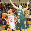 WARREN DILLAWAY / Star Beacon<br /> LINDSEY MAYLE of Geneva drives to the basket by Jordan Korinek of Akron St. Vincent St. Mary's on Tuesday night during a Division II regional semifinal at Barberton.