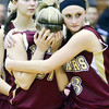 WARREN DILLAWAY / Star Beacon<br /> KELSEA BROWN (3) of Pymatuning Valley comforts Geena Gabriel after the Lady Lakers lost a Division III regional semifinal game to Beachwood at Cuyahoga Falls.