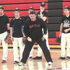 WARREN DILLAWAY / Star Beacon<br /> SCOTT BARBER, Jefferson baseball coach, demonstrates a drill on Tuesday during practice in the gymnasium.