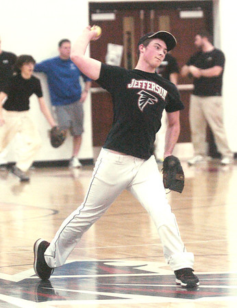 WARREN DILLAWAY / Star Beacon<br /> JUSTIN DREWS  prepares to throw on Tuesday during a Jefferson baseball practice.