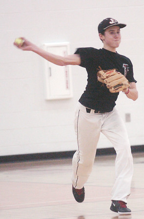 WARREN DILLAWAY / Star Beacon<br /> TROY BLOOMS  prepares to throw on Tuesday during a Jefferson baseball practice.