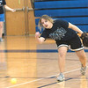 WARREN DILLAWAY / Star Beacon<br /> LORRAINE MILLER rolls a ball to a teammate on Tuesday during a fielding drill at Grand Valley's softball practice.