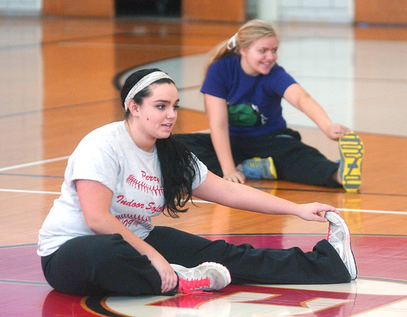 WARREN DILLAWAY / Star Beacon<br /> GABRIELLE PATETE (foreground) and Katie Boomhower stretch before Edgewood softball practice Monday afternoon in Ashtabula Township.