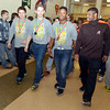 WARREN DILLAWAY / Star Beacon<br /> KYLE CONEL (second from right), Lakeside 195 pound Division I state wrestling champ, walks four Lakeside junior high students through the school's hallways on Friday afternoon. (From left with medals) Parker Meaney, Spencer Loftus, DeShauwn Jones, and Jacob Lagoa (far right), all members of the Lakeside Junior High wrestling club, will all  participating in the state middle school championship meet.