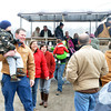 WARREN DILLAWAY / Star Beacon<br /> VISITORS TO the Bissell Maple Farm disembark from a ride in a horsedrawn wagon on Saturday morning during the Maple Madness Tour stop in Trumbull Township.