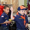 WARREN DILLAWAY / Star Beacon<br /> IAN PROUTY, 7,  (with arm raised) celebrates after his car won a heat during the Cub Scout Pack 58 Pinewood Derby on Saturday at the Geneva United Church of Christ. Charlie Myers (left foreground), 7, watches the action with his fellow competitors.