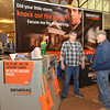 WARREN DILLAWAY / Star Beacon<br /> GARY DANIELS of Painesville chats with Mike Schmidt of Shepp Electric on Saturday during the Ashtabula County Home Show at the Ashtabula Towne Square in Ashtabula Township.