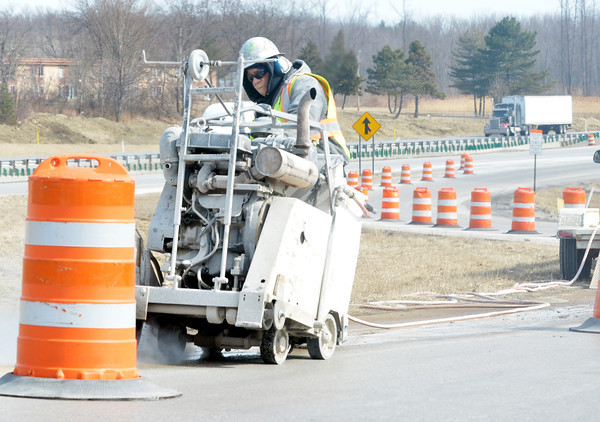 WARREN DILLAWAY / Star Beacon<br /> DOT DRILLING work on an Interstate 90 entrance ramp in Austinburg Township at the Route 45 intersection on Tuesday afternoon.