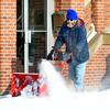 WARREN DILLAWAY / Star Beacon<br /> RON BRAIS clears snow in front of the First Baptist Church     along Park Avenue in Ashtabula on Thursday morning.