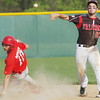 WARREN DILLAWAY / Star Beacon<br /> SCOTT DAVIDSON of Jefferson tries to turn a double play after forcing Matt DiDonato at second base on Thursday during a game at Jefferson.