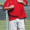 WARREN DILLAWAY / Star Beacon<br /> BILL LIPPS, Edgewood baseball coach, signals to a base runner on Thursday during a game at Jefferson.