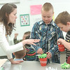 WARREN DILLAWAY / Star Beacon<br /> JENNIFER LASHER, a teacher at Christian Faith Academy works with students Jack Leehan (center) and Gabe Hutchison during a Mother's Day project at the Ashtabula school.
