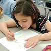 WARREN DILLAWAY / Star Beacon<br /> CHLOE ELLSWORTH works on a Mother's Day card at Christian Faith Academy.