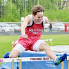 WARREN DILLAWAY / Star Beacon<br /> CONNOR LYNCH of Edgewood competes in the 300 meter hurdles on Saturday during the Karl Pearson Ashtabula County Track Meet at Pymatuning Valley.