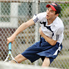 WARREN DILLAWAY / Star Beacon<br /> JACOB EDWARDS of Conneaut follows through on a serve during a home second singles match with Matt Pinelli of St. John on Monday.
