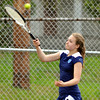 WARREN DILLAWAY / Star Beacon<br /> JESSICA DISALVATORE of St. John returns the ball during a third singles match with Rashad Al-Arabi of Conneaut on Monday in Conneaut.