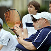 WARREN DILLAWAY / Star Beacon<br /> DAVE SIMPSON, Conneaut tennis coach, watches the action on Monday during a home match with St. John. Conneaut players (from left) Sean O'Meara, Scott Gerdes, Adam Bissett and Alex Gerdes and Tyee Stewart (far right) surround Simpson.