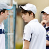 WARREN DILLAWAY / Star Beacon<br /> DAVE SIMPSON, Conneaut tennis coach, talks with doubles team Scott (left) and Alex Gerdes on Monday afternoon during a home match with St. John.