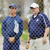 WARREN DILLAWAY / Star Beacon<br /> DAVE SIMPSON, Conneaut tennis coach, (right) watches the action with Todd Nassief, St. John coach, on Monday afternoon at Conneaut.