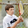 WARREN DILLAWAY / Star Beacon<br /> ADAM LAITINEN of Conneaut returns the ball during a home first singles match with Tony Massucci of St. John on Monday.