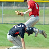 WARREN DILLAWAY / Star Beacon<br /> BRANDON KOVACH, Geneva shortstop, leaps for the  throw while Teenan Irish of Harvey arrives at second base during Division II sectional action at Geneva on Tuesday afternoon.