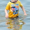 WARREN DILLAWAY / Star Beacon<br /> BRAYDIN BURLINGHAM, 4, of Jefferson, cools off with a dip in Lake Erie on Tuesday at Lake Shore Park.