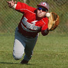 WARREN DILLAWAY / Star Beacon<br /> BRANDON KOVACH of Geneva makes a diving catch on Monday during a Division II sectional semifinal game at Edgewood.