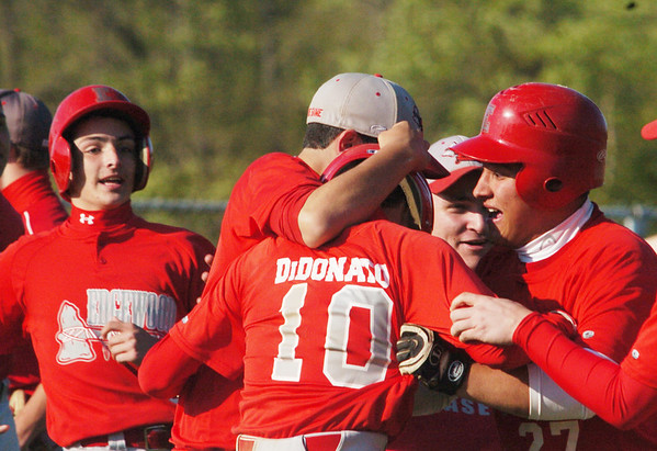 WARREN DILLAWAY / Star Beacon<br /> MATT DIDONATO (10) of Edgewood is mobbed by teammates after knocking in the winning run on Monday during a home Division II sectional semifinal game against Geneva.