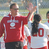 WARREN DILLAWAY / Star Beacon<br /> STEVE CUNHA, Edgewood softball coach, high fives pitcher Gabriella Patete with teammate Ashten Noce (right) looking on Monday after beating Conneaut.