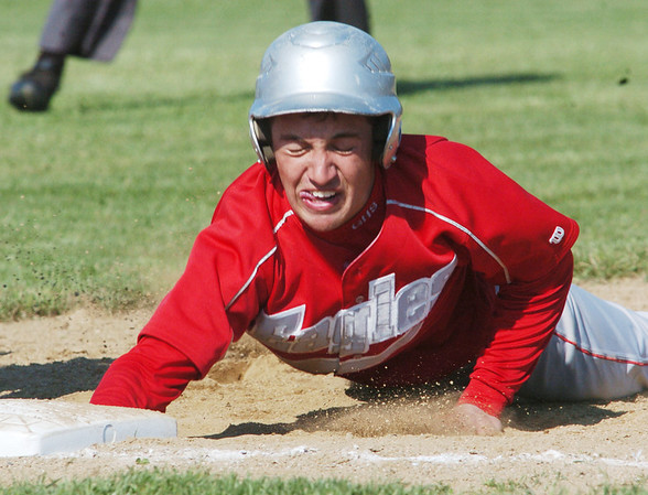 WARREN DILLAWAY / Star Beacon<br /> STEVE JEWELL of Geneva slides back into first base Monday during a Division II sectional semifinal game at Edgewood.