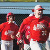 WARREN DILLAWAY / Star Beacon<br /> STEVE PERKIO (37) and Edgewood teammate Devin Maurer (left) celebrate after Tony Magda scored the only run of the game to beat Geneva during a Division II sectional semifinal game at Edgewood Monday afternoon.